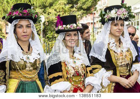 SELARGIUS, ITALY - September 8, 2013: Former marriage Selargino - Sardinia - portrait of beautiful girls in traditional Sardinian costume