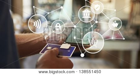 Conceptual Shot Of Man Using Card Reader On Digital Tablet