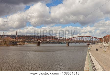 PRAGUE CZECH REPUBLIC - MARCH 29 2016: Vysehrad railway bridge over Vltava River in Vyton district of Prague. Original bridge was constructed in 1872 and replaced by new one in 1901