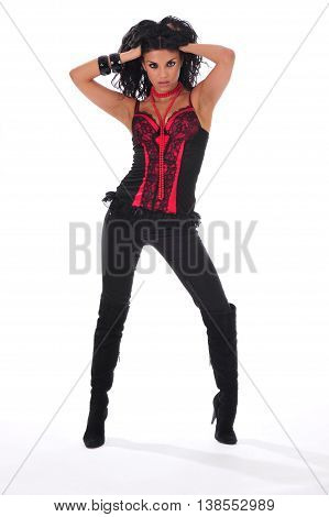 Sexy brunette in a red corset holding her hair up
