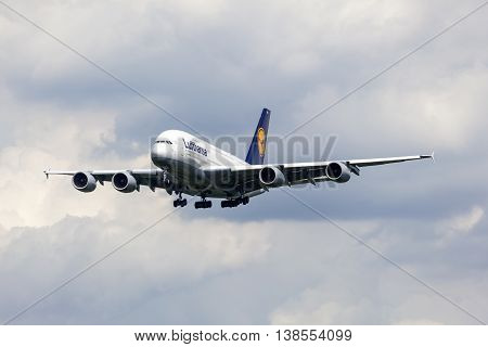 FRANKFURT GERMANY - JULY 12 2016: Airbus A380 from the Lufthansa airline approaching Frankfurt Main international airport