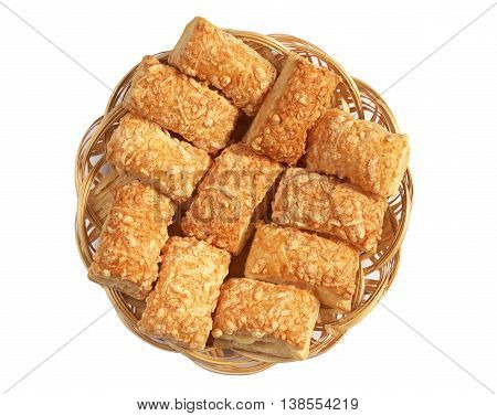 Puff cookies with cheese in wicker plate isolated on white background top view