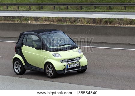 FRANKFURT GERMANY - JULY 12 2016: Smart Fortwo driving on the highway in Germany
