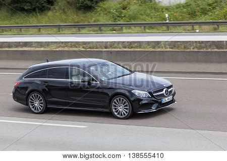 FRANKFURT GERMANY - JULY 12 2016: Mercedes Benz CLA Shooting Brake luxury estate car driving on the highway in Germany