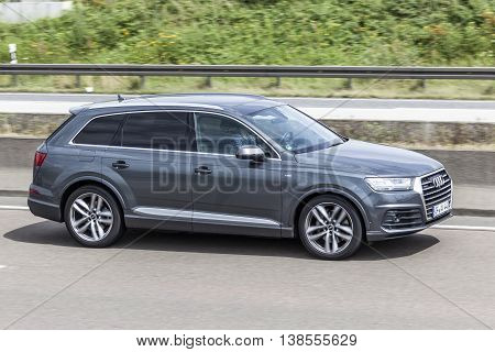 FRANKFURT GERMANY - JULY 12 2016: AUDI Q7 luxury SUV driving on the highway in Germany