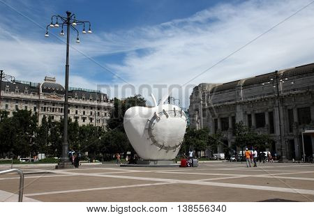 MILAN ITALY - JUNE 27 2016: the monumental sculpture La Mela Reintegrata (The Reintegrated Apple) by Michelangelo Pistoletto in front of the central station