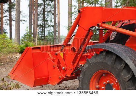 Modern red Bulldozer with bucket close up