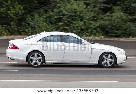 FRANKFURT GERMANY - JULY 12 2016: Mercedes Benz CLS luxury four door coupe driving on the highway in Germany