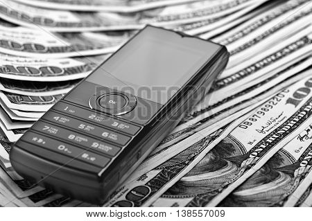 Close Up Mobile Phone On The Money Background