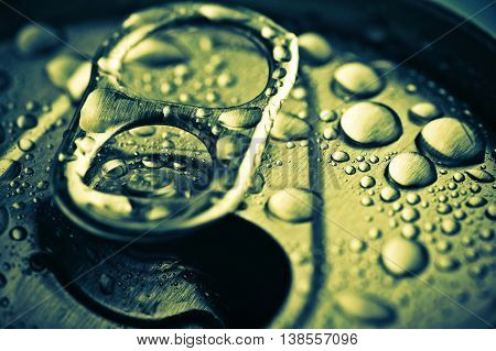 Close Up Opened Aliminium Jar With Water Drops