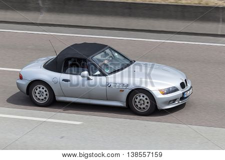 FRANKFURT GERMANY - JULY 12 2016: BMW Z3 convertible roadster driving on the highway in Germany