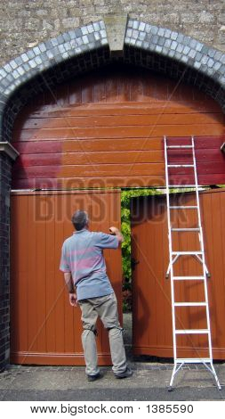 A Man Painting Door