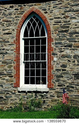 Sleepy Hollow NY - July 9 2009: Elegant gothic-style nave window at the 1685 Old Dutch Church of Sleepy Hollow