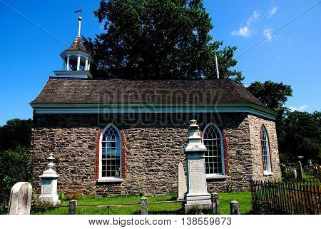 Sleepy Hollow NY - July 9 2009: 1685 Old Dutch Church of Sleepy Hollow the oldest church in New York State and surrounding burial ground