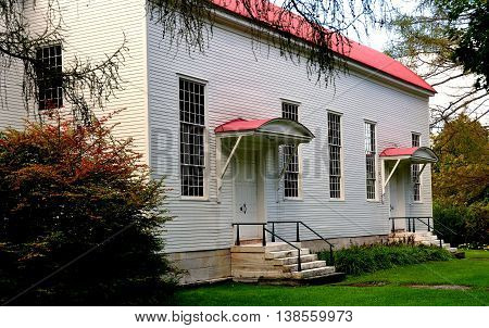New Lebanon New York - September 17 2014: Early 19th century Shaker Meeting House with dual covered entrance doorways