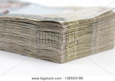A stack of Bahraini Dinars on a white background