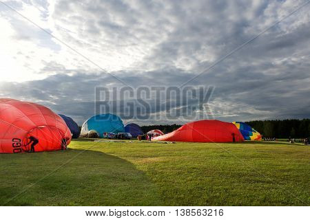 Hot air balloons preparing for the flight n nice sunset in July 9, 2016 in Birstonas, Lithuania. Hot air balloon preparing for flight