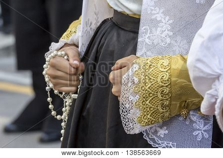 CAGLIARI, ITALY - May 1, 2015: 359 ^ Religious Procession of Sant'Efisio - Sardinia - especially the sleeves of a traditional Sardinian costume worn by a girl