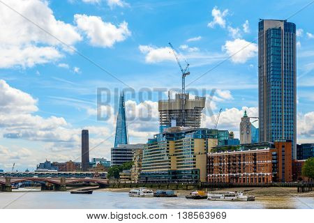 London UK - July 5 2016 - London cityscape including Blackfriars Railway Bridge Tate Modern The Shard Sea Container House OXO Tower and South Bank Tower