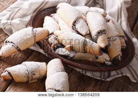 Homemade Crescent With Poppy Stuffing Close-up On A Plate. Horizontal