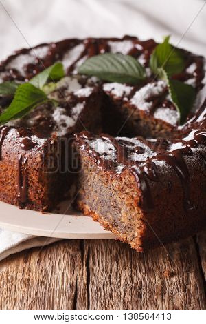 Poppy Seed Cake With Chocolate Frosting And Mint Close-up. Vertical