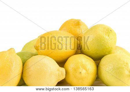 Pile of lemons on a white background