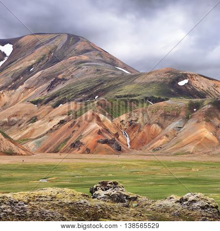 Rhyolite mountains smoldering underground heat. In the hollows lie unmelted snow patches from last year. Iceland in July