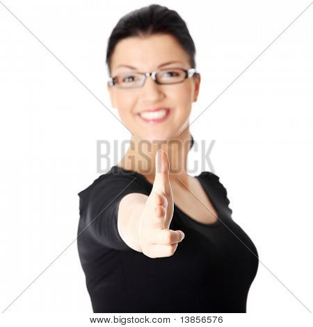 Young beautiful happy caucasian woman pointing on you ,isolated on white. Focus on hand