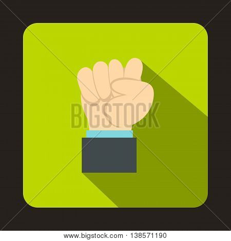 Raised up clenched male fist icon in flat style on a green background