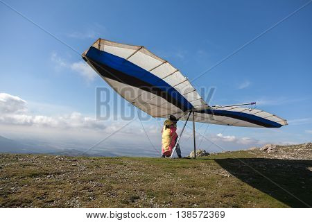 Hang glider prepares for take off. Sport concept