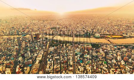Aerial View Of The Sprawling Tokyo Cityscape With A View Of The Sumida River