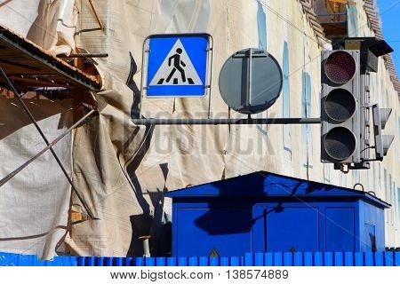 Construction site in the city. The city's infrastructure.Traffic sign, pedestrian crossing.Traffic light.