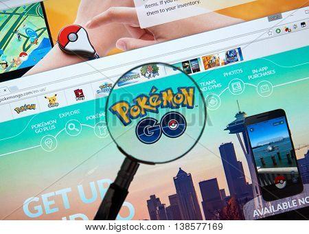 MONTREAL CANADA - JULY 14 : Pokemon Go home page under magnifying glass. Pokemon Go a free-to-play augmented reality mobile game developed by Niantic for iOS and Android devices.