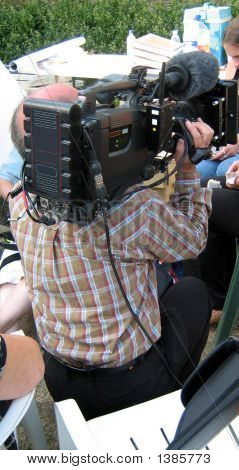 Photographer Taking Photo In Tv Show/Programme