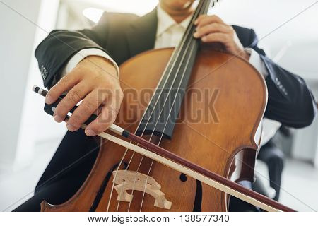 Professional cello player's hands close up unrecognizable person