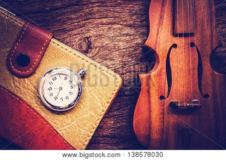 Blank Pocketbook with violin and old pocket watch