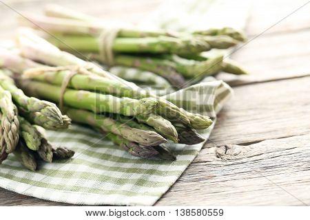 Fresh Green Asparagus On A Grey Wooden Table