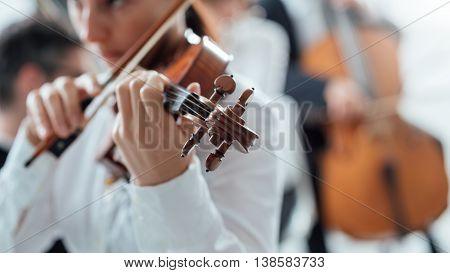 Talented Violinist Playing With Orchestra