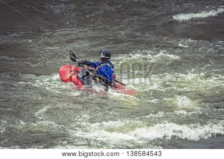 Stockholm, Sweden - April 04, 2016:man Kayaking In Fast Flowing Rapids. Kayaking In Stockholm. Canoe