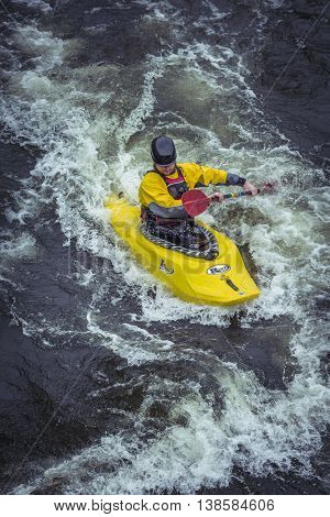 Stockholm, Sweden - April 04, 2016:man Kayaking In Fast Flowing Rapids. Kayaking In Stockholm. Canoe