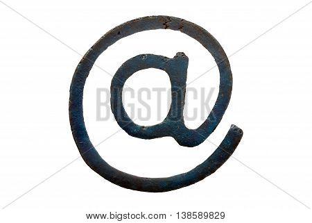 A macro and isolated shot of a bronze computing arroba symbol (at sign)