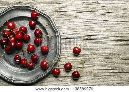 Fresh cherries on wooden table close up