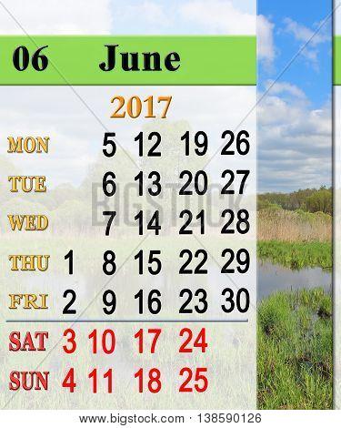 calendar for July 2017 on the background of summer landscape