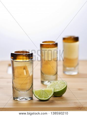 three small sips of tequila with lemon