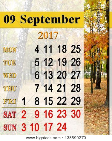 calendar for September 2017 with park with trees and yellow leaves