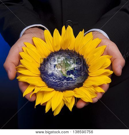 Businessman with the world in his hands (Elements of this image furnished by NASA)
