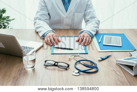 Professional doctor in his office working at desk healthcare and hospitals concept