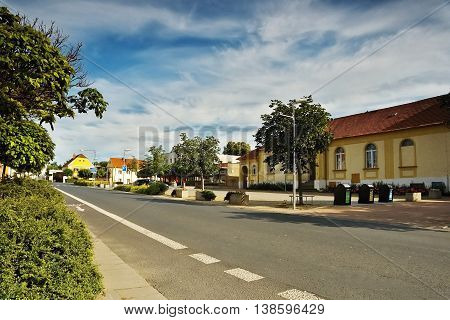 2016/07/07 Brozany nad Ohri Czech republic - main road in the village Brozany nad Ohri leaders around the square Palackeho namesti with parking during the summer tourist season