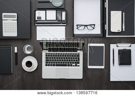 Corporate business desktop with laptop digital tablet accessories and work equipment flat lay banner