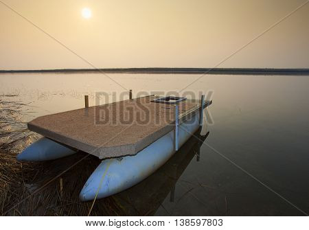 Sun rising over a lake in the north end of Saskatchewan in Canada